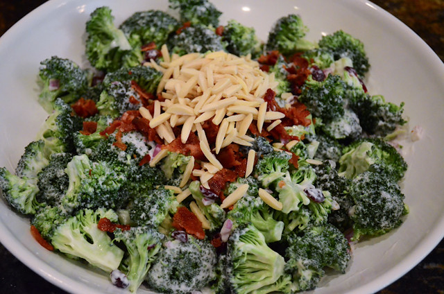 The almonds and crumbled bacon are added to the Broccoli Salad.