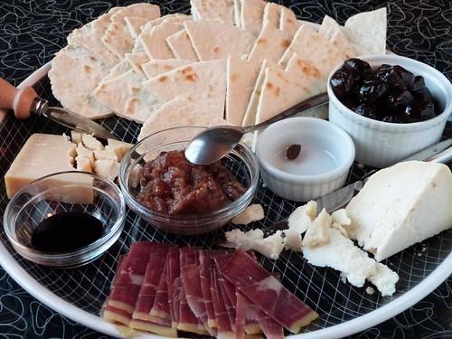 Piadina, formaggio di fossa, Parmigiano-Reggiano, savor, olives, boar prosciutto