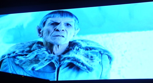 Spock, wearing a fur trimmed coat, tells his story of being marooned on a frozen planet, Delta Vega, Alpha Quadrant, fiction, Star Trek film 2009, on TV, Seattle, Washington, USA by Wonderlane