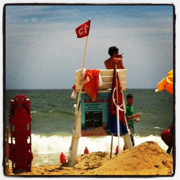 #rehobothbeach Lifeguards at working hard today, huge surf and riptides, 3 rescues in last half hour!