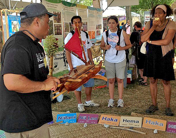 <p>Navigator-in-Residence Kalepa Baybayan, from the University of Hawaii at Hilo's Imiloa Astronomy Center of Hawaii, teaches visitors about non-instrument navigation at the University of Hawaii tent at the Smithsonian Folklife Festival.</p>