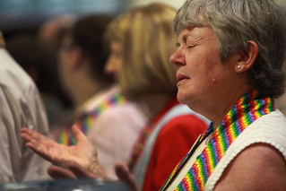 Deborah Maria prays and protests at General Conference. A UMNS photo by Kathleen Berry
