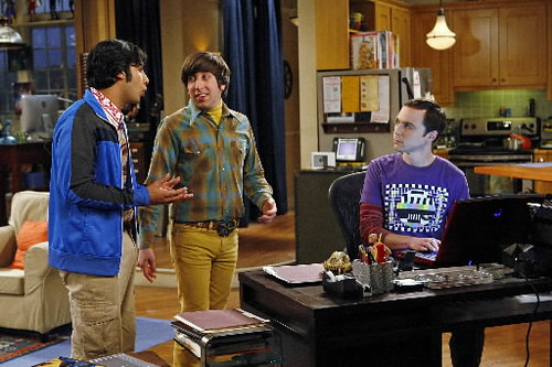 three guys from the Big Bang Theory in an apartment, dressed like dweebs
