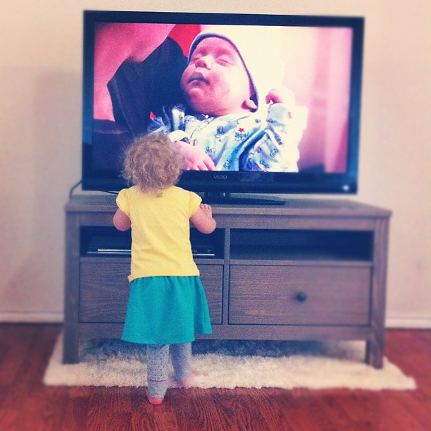 "Paisley LOVES babies. So when one is on TV, she runs screaming ""Bay-bee! Bay-bee!"""