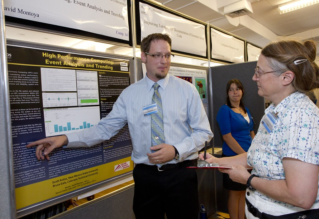 Bruce Gale of High Performance Computing Systems discusses his research with Student Symposium judge Georgia Pedicini.