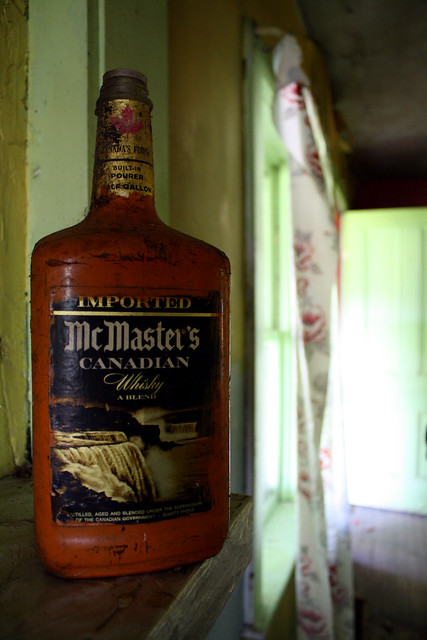 Half gallon bottle of 80 proof McMaster's Canadian Whiskey, half full or half empty, depending on your perspective or philisophical outlook.