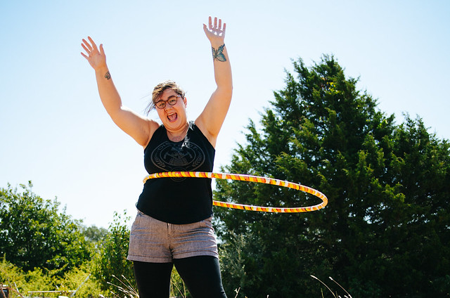 Vanessa spins the hula hoop in her backyard