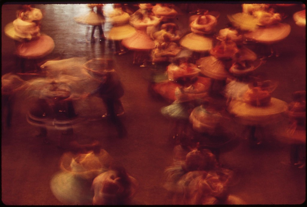 Skirts whirl in the 33rd Annual Square Dance Festival, held in Pershing Auditorium, May 1973