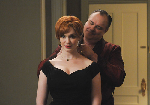 Joan getting a necklace from Herb