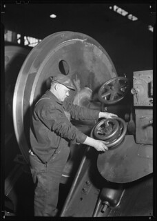 Railroad parts. Baldwin Locomotive Works. Machinist machining wheel to fit driving pin on above wheels (80 inches in diameter) on newest type of locomotive, March 1937