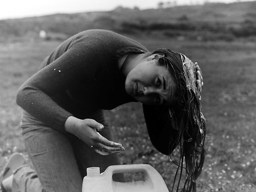 Girl washing hair Scilly Isles 1976