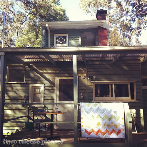 zig zag quilt on the front porch of a two storey house