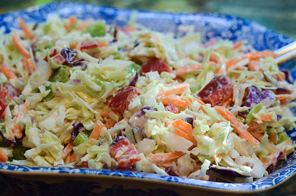 Closeup of cole slaw on a decorative plate.