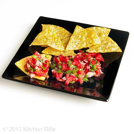 Salsa on Black Plate with Tortilla Chips