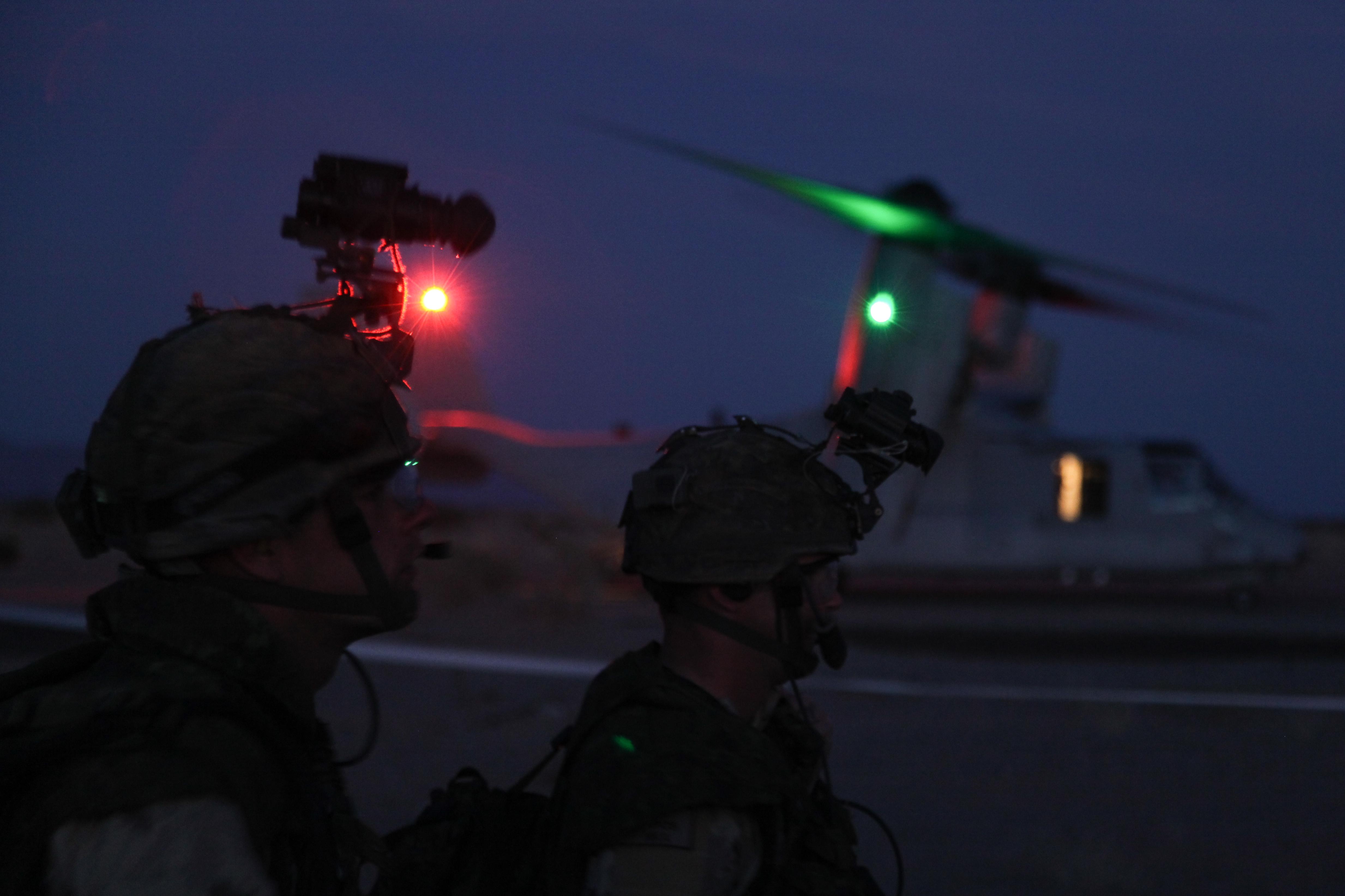 Soldiers with 3rd Battalion Royal Canadian Regiment prepare to load onto USMC MV-22 Ospreys near Yuma, Ariz., April 18, 2012