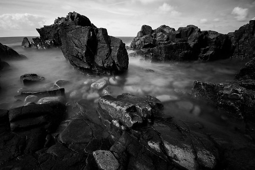 kullaberg, black rocks and white stones