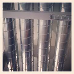 plastic wrap(0.0), interior design(0.0), pipe(1.0), metal(1.0), cylinder(1.0),
