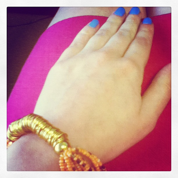 Hip new bracelet. Trendy blue nails.  Bright pink skirt. I kill myself with how kewl I am.