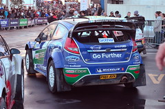 touring car(0.0), race car(1.0), auto racing(1.0), automobile(1.0), rallying(1.0), touring car racing(1.0), racing(1.0), vehicle(1.0), sports(1.0), race(1.0), automotive design(1.0), ford focus rs wrc(1.0), motorsport(1.0), rallycross(1.0), city car(1.0), world rally car(1.0), ford(1.0), race track(1.0), world rally championship(1.0),