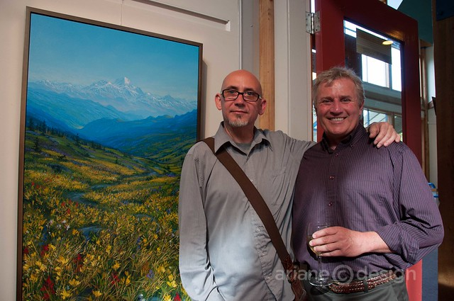 "Anthony Matthews, Pegasus Gallery poses with artist Randolph Parker and his ""Wells Gray Inspired"""
