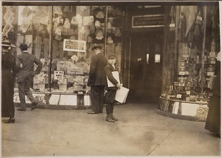 Photograph of Earle Frere, a young truant selling extra during school hours Monday on Pennsylvania Avenue, April 1912