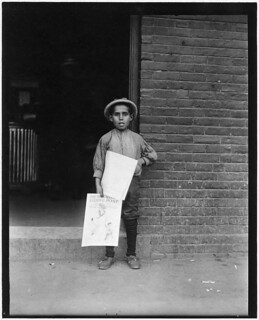 Small Newsie at depot. Burlington, Vt, September 1910