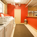 A bright accent wall adds whimsy to the in-building laundry room.