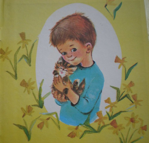 Vintage boy holding cat