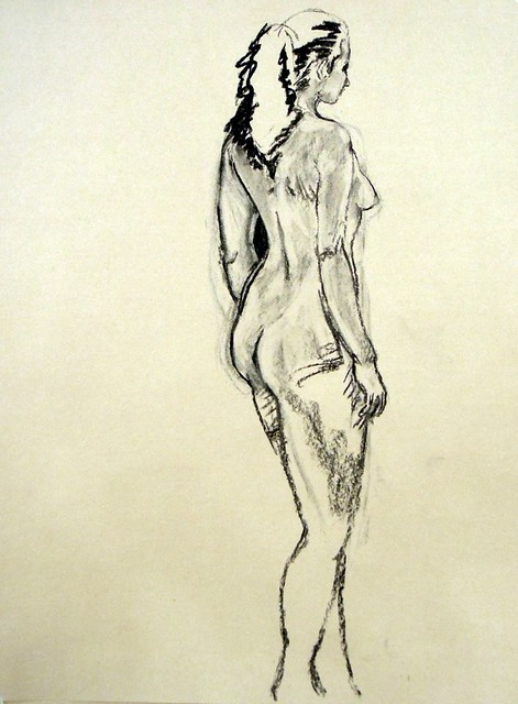 Standing nude woman from behind