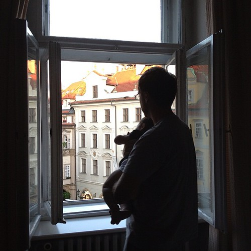 C and her papa looking out of our hotel window in Prague