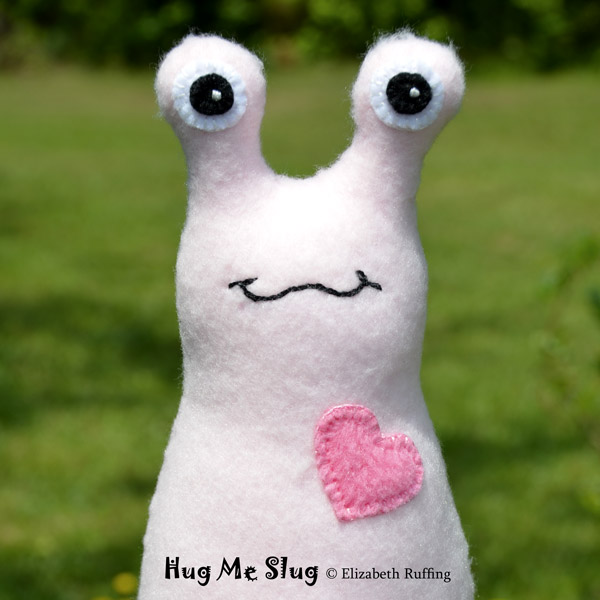 Light pink Hug Me Slug, original art toys by Elizabeth Ruffing