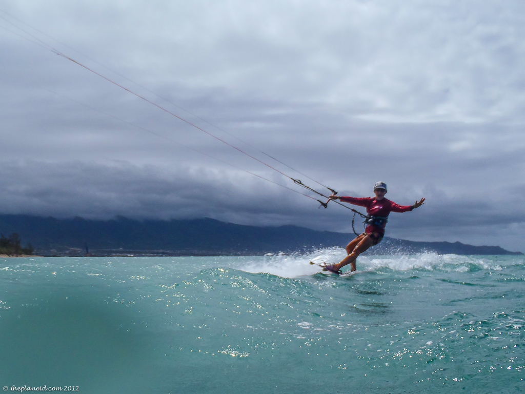 adventure travel kiteboarder catching a wave in Maui
