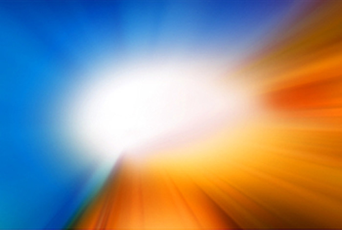 Image of light glowing between orange and blue color spectrums