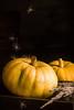 Pumpkins on dark wooden table.