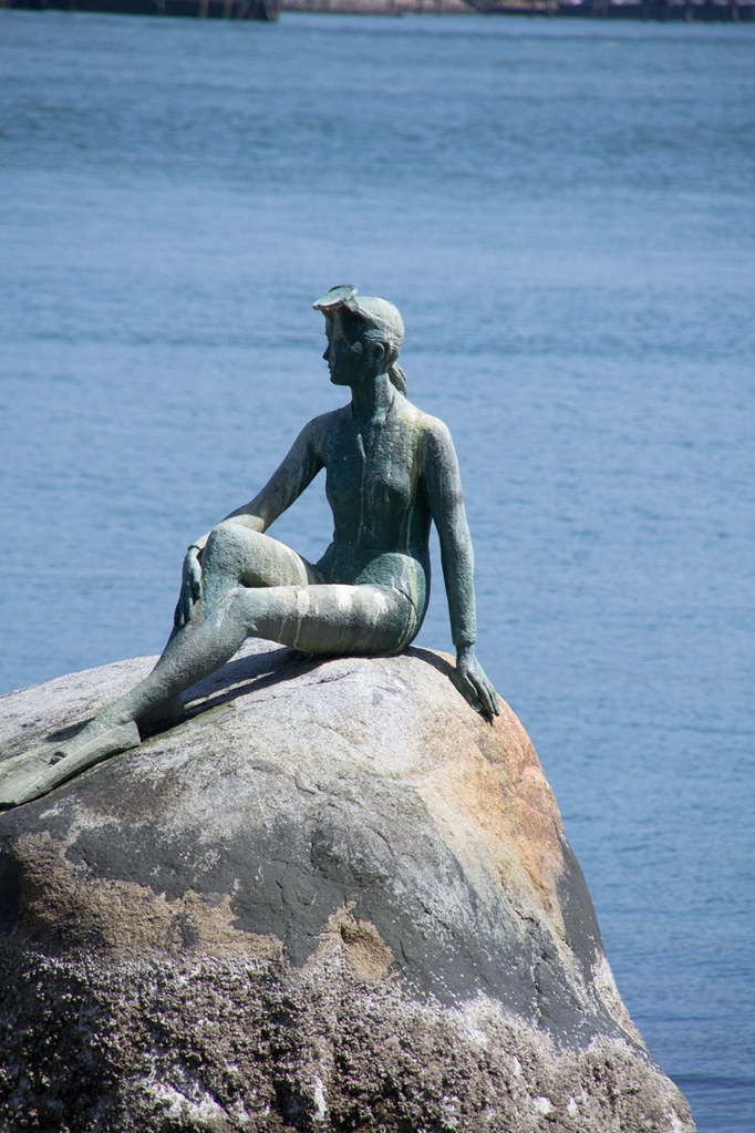 Sculpture that looks like Copenhagen's Little Mermaid Statue | Girl in a Wetsuit
