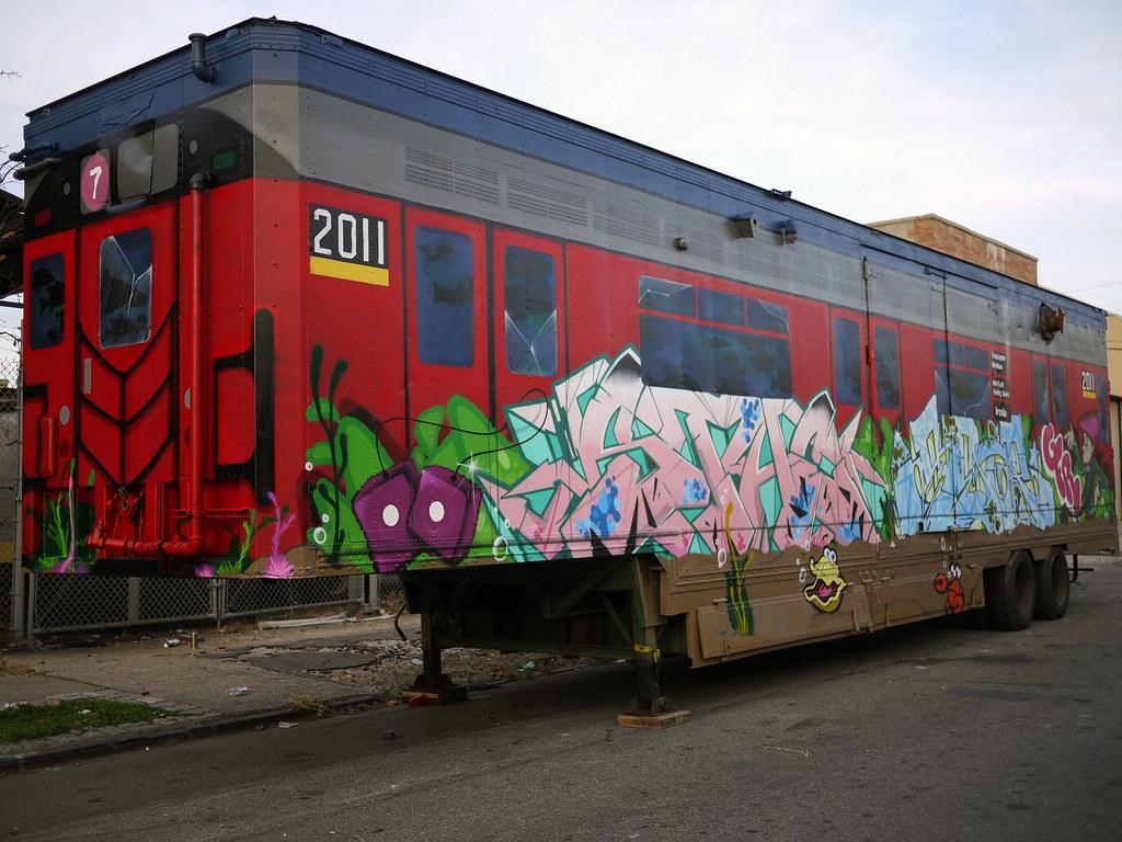 7 train red bird subway car graffiti