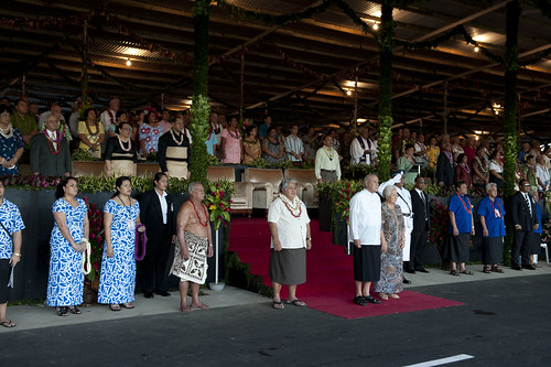 His Highness Tui Atua Tupua Tamasese, Her Highness Masiofo Filifilia, and Hon. Prime Minister Tuilaepa Lupesoliai Neioti Aiono Sailele Malielegaoi stand before the reviewing stand at the start of opening ceremonies.