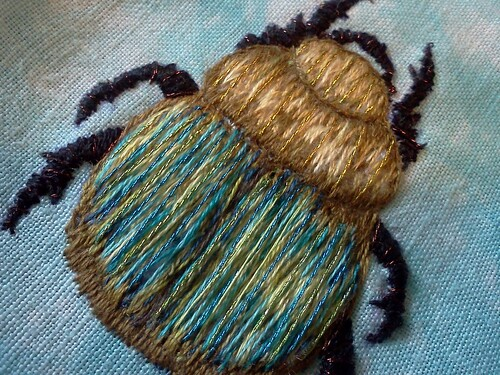 scarab, finished with metallic thread