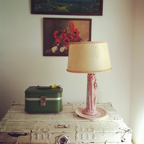 old trunk, funky lamp and lithographs in the guestroom #thisoldhouse #spaces #home #interiors #maine #maineaesthetic