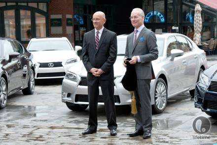 Tim Gunn and the Lexus guy standing by the cars