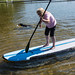 Mom laughs as she tries stand up paddleboarding