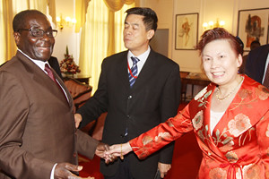 Outgoing Chinese Ambassador to Zimbabwe Mr Xin Shunkang and his wife Luo bid President Mugabe farewell at State House in Harare on May 9, 2012. The two countries have a long history of cooperation and solidarity. by Pan-African News Wire File Photos