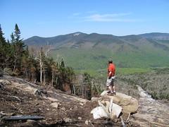 Hiker admiring Big Slide across John's brook valley