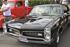 auto show(0.0), full-size car(0.0), hot rod(0.0), convertible(0.0), automobile(1.0), automotive exterior(1.0), vehicle(1.0), antique car(1.0), sedan(1.0), vintage car(1.0), land vehicle(1.0), muscle car(1.0), pontiac gto(1.0), coupã©(1.0), motor vehicle(1.0),