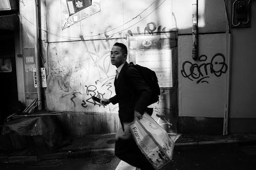 Man with graffiti wall, Shibuya. Tokyo 2012