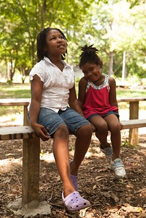 essica Easterleing, 9, and Ondrea Bryant, 3, sit in a pocket park on the Farmway.