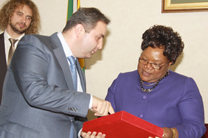Republic of Zimbabwe Vice President Joice Mujuru receives a gift from the visiting Russian Deputy Minister of Industry and Trade Georgy Kalamanov at her offices in Harare on July 19, 2012. by Pan-African News Wire File Photos