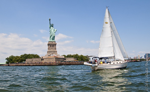 Liberty and the sailboat by Alida's Photos