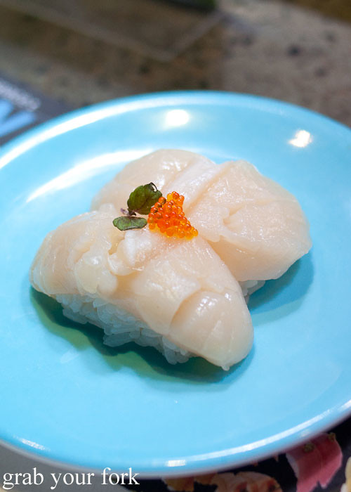 Raw scallop nigiri sushi at Umi Kaiten-Zushi
