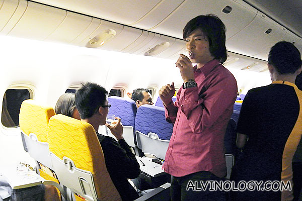 Chua En Lai (above) and Michelle Chong from The Noose went about the plane to interact with everyone